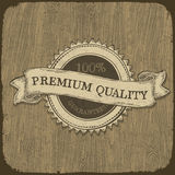 Vintage label on wooden texture. Royalty Free Stock Images