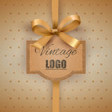 Vintage label with a yellow bow Royalty Free Stock Images