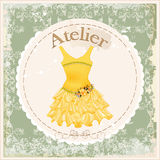 Vintage label with yellow dress Stock Image