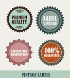 Vintage labels. Four vintage labels isolated over beige background. vector Royalty Free Stock Images