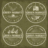 vintage labels of green market with tractor and vegetable Royalty Free Stock Photos
