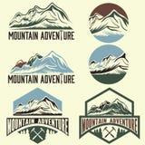 Vintage labels mountain adventure Stock Photos