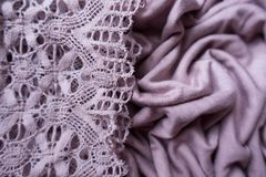 Vintage lace on draped pink fabric. Vintage lace on draped pink viscose fabric Royalty Free Stock Photos