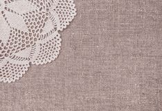 Vintage lace fabric border on the old burlap textile. Background stock photos