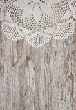 Vintage lace fabric border on the old wood Royalty Free Stock Photo