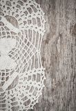 Vintage lace fabric border on the old wood. En background royalty free stock photos