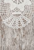 Vintage lace fabric border on the old wood Stock Photos