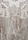 Vintage lace fabric border on the old wood Royalty Free Stock Image