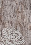 Vintage lace fabric border on the old wood. En background stock photography