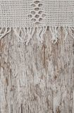 Vintage lace fabric border on wooden background Stock Photos