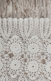 Vintage lace fabric border on wooden background Stock Photo
