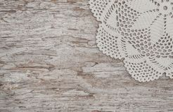Vintage lace fabric border on wooden background Stock Photography