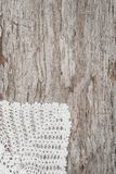 Vintage lace fabric border on wooden background Royalty Free Stock Images