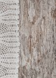 Vintage lace fabric border on wooden background Stock Image