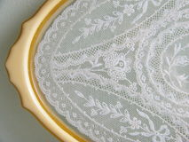 Vintage Lace Tray. Vintage Celluloid Bakelite Vanity Tray with Floral Tambour Net Lace Insert Yellow Gold Butterscotch Orange Tone Royalty Free Stock Images