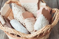 Vintage lace. On the wooden bobbin in a basket Royalty Free Stock Photos