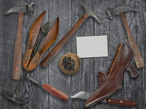 Vintage ladies shoe and shoemakers tools Stock Photography