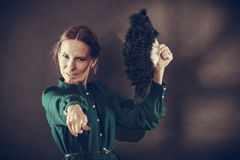 Vintage lady with feather fan on dark Royalty Free Stock Photography