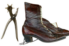 Vintage lady's boot with punch tool Stock Images