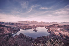 Vintage Lake with Island in Mountains Royalty Free Stock Photography