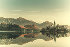 Vintage Lake with Island in Mountains Stock Image