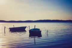 Vintage lake landscape with boats. Royalty Free Stock Photos