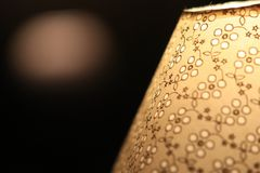 A vintage lamp beside a bed Royalty Free Stock Photography