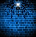 Vintage lamp on the blue brick wall. Vintage lamp on the background of the dark blue brick wall. There is plenty of room for additional elements and text Royalty Free Stock Photos