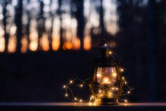Vintage lamp with a candle and lights at night stock photos