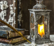 Vintage lamp for the candle and old books Stock Photography
