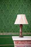 Vintage lamp on chimney on green retro pattern background Royalty Free Stock Photography