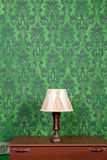 Vintage lamp on chimney on green retro pattern background Royalty Free Stock Photo
