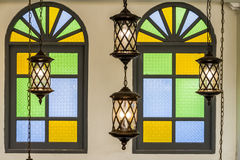 Vintage lamp and colorful window Royalty Free Stock Images