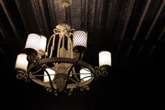 Vintage lamp glowing and illuminating in the dark. Cold and oriental. Royalty Free Stock Photography