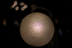 Vintage lamp glowing and illuminating in the dark. Cold and oriental. Royalty Free Stock Image