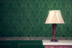 Vintage lamp on green pattern background on chimney Royalty Free Stock Photos