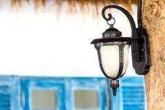 Vintage Lamp hanging on wood Stock Photo
