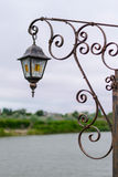 Vintage lamp on an iron gate Stock Image