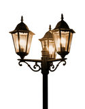 Vintage lamp isolated white. Urban street night scene: vintage streetlamp (lamp post)  isolated on white. Can be used as an abstract background (backdrop Stock Image
