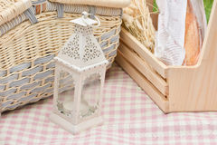 Vintage lamp and picnic basket Stock Photo