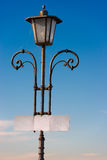 Vintage Lamp Post with Empty Signboard Stock Photos