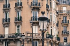 Vintage lamp post with old building background royalty free stock photography
