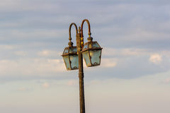 Vintage lamp post under cloudy sky Royalty Free Stock Photo