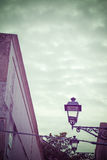 Vintage lamp under a cloudy sky in vintage tone Royalty Free Stock Photography