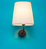 Vintage lamp on the wall. Beautiful vintage lamp on the blue wall stock photography