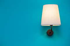 Vintage lamp on the wall. Beautiful vintage lamp on the blue wall royalty free stock photography