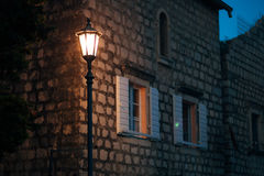 Vintage lamp on the wall on street Stock Photography