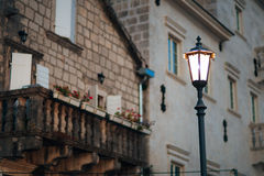 Vintage lamp on the wall on street Royalty Free Stock Photo