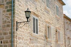 Vintage lamp on wall on street Royalty Free Stock Images
