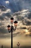 Vintage lamppost. Vintage lamppost with pink lanterns at sunrise Stock Image
